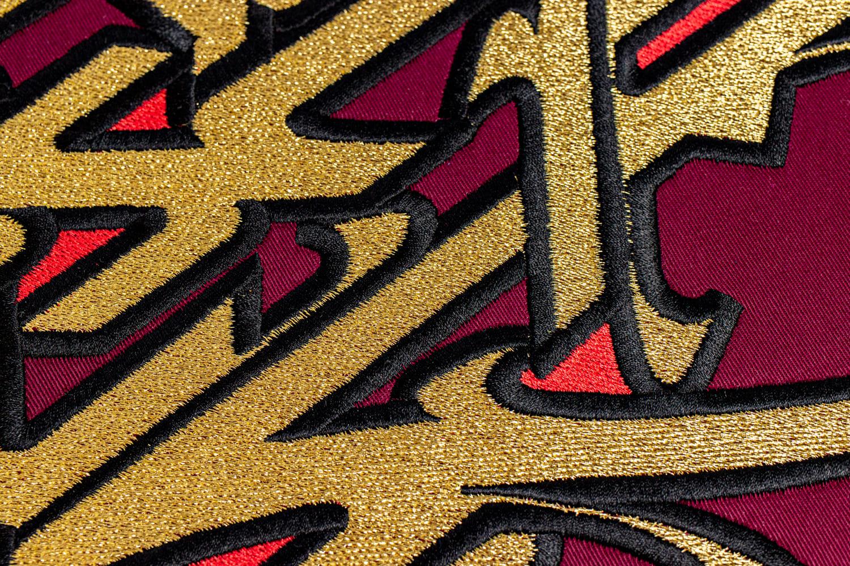 Détails sur l'oeuvre textile Alquimia, 2021 de l'artiste urbain Asu.